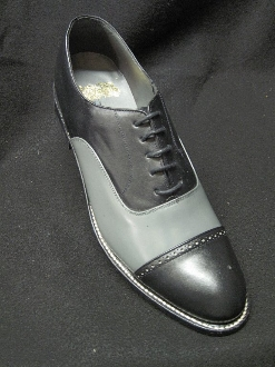 tone leather shoes in the classic wingtip style. Made by Greenspan's, with genuine leather uppers, leather lined, leather soles, with a padded bottom for extra comfort. Color Black and White combination. Made in Mexico..